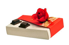 Rose gift box and chocolate. Valentine's day gift: fabric red rose recycled carboard gift box with two yummy pieces of chocolate Stock Image
