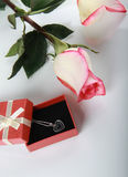 Rose and gift with jewelry decoration Stock Photography