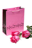 Rose gift package and three roses Stock Images