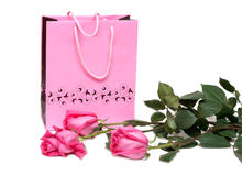 Rose gift package and three roses Stock Image