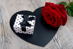 A rose and a gift for valentine day Stock Photography