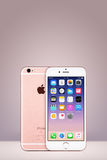 Rose Gold Apple iPhone 7 with iOS 10 on the screen on vertical gradient background with copy space Stock Photography