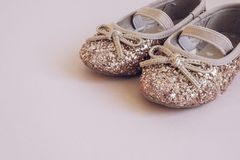 Rose Gold Glitter & Pink Toddler Baby Ballet Pumps. Rose Gold Glitter & Pink Toddler Ballet Pumps - pink background stock photo