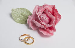Rose with gold rings Royalty Free Stock Images