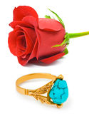 Rose and golden ring Stock Image