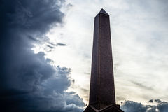 Rose Granite Obelisk Surrounded by Blue Grey Storm Clouds Royalty Free Stock Photo