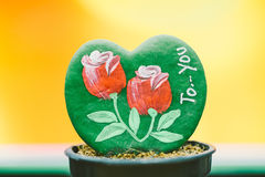 Rose on green leave plant. Rose painted on green leave, mean to love or valentine royalty free stock images