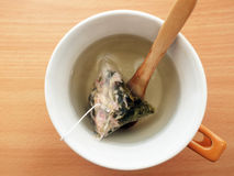 Rose green tea bag. In a cup Royalty Free Stock Image