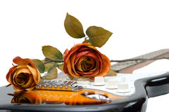 Rose on a guitar Stock Photo