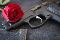 Rose and Gun. Concept Arts Love and Heady Violence Royalty Free Stock Photography