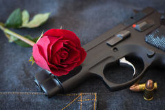 Rose and Gun. Concept Arts Love and Heady Violence Stock Photos