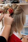 Rose in hair royalty free stock photography