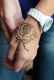Rose on the hand Royalty Free Stock Photo