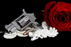 Rose with handgun Royalty Free Stock Image