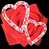 Rose and hart. Two harts on a background of a red rose Royalty Free Stock Photography