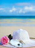 Rose ,hat and black pearls of Tahiti before  sea Royalty Free Stock Images
