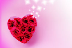 Rose heart. Red rose heart of plastic and fabric with stars on rosa background Stock Photography