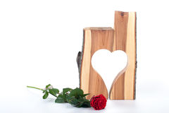 Rose and heart. Made of wood on white background royalty free stock photo