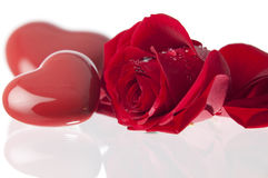 Rose and heart Valentines day.GN. Red valentins heart and a red rose laying on a glass surface.GN stock image