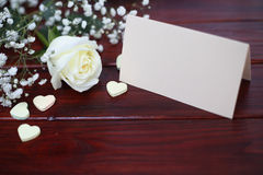 Rose, hearts and card on table Royalty Free Stock Photography