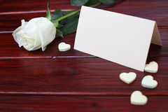 Rose, hearts and card on table Stock Images