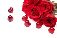 Rose and hearts. Red roses and glass hearts Royalty Free Stock Photo