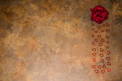 Rose and hearts of St. Valentine`s on a rusty background. Rose and hearts of St. Valentine`s on a rusty vintage background Stock Photos