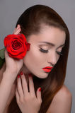 Rose on her head. Portrait of beautiful women holding rose near Royalty Free Stock Photos
