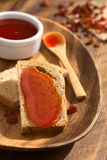Rose Hip Jam on Bread Stock Images