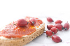 Rose hip sandwich. Bread with jam made from rose hips Royalty Free Stock Photo