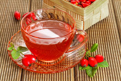 Rose hip tea with fresh berries Royalty Free Stock Photography