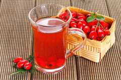Rose hip tea with fresh berries Stock Photography