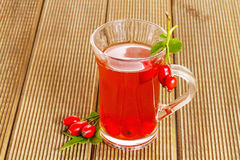 Rose hip tea with fresh berries Royalty Free Stock Photo