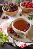 Rose hip tea, fresh and dried berries. Rustic style stock photo