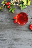 Rose hip tea with organic berry on black background Royalty Free Stock Photos