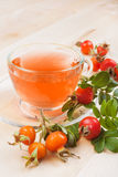 Rose hip tea and red berries Royalty Free Stock Photo