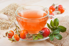 Rose hip tea and red berries. Rose hip tea with red berries and chamomile stock photo