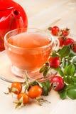 Rose hip tea and red teapot Royalty Free Stock Photos