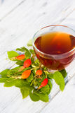 Rose Hip Tea. On wooden background Stock Photo