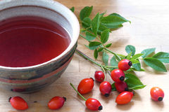 Rose hips and rose hip tea in a ceramic cup Royalty Free Stock Photos