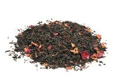 Rose infused black tea. Rose infused whole leaf organic black tea on a white background royalty free stock image