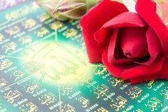 Rose and islamic script Stock Photos