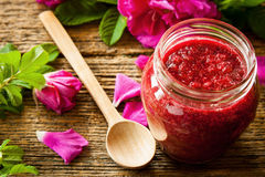 Rose jam. Homemade jam made from damascus petal rose on wooden table. Selective focus Royalty Free Stock Photo