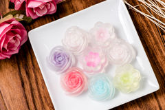 Rose jelly in plate on wood table Royalty Free Stock Photos