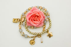 Rose and jewelry Royalty Free Stock Images
