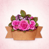 Rose and lilac flowers bouquet with craft paper ribbon Royalty Free Stock Photography