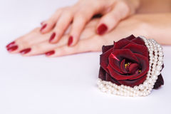 Rose, manicure and pearls Royalty Free Stock Photography
