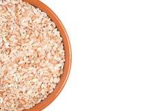 Rose matta Rice in bowl. Rose matta Rice in brown bowl white background Stock Photo