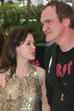 Rose McGowan and Quentin Tarantino. CANNES, FRANCE - MAY 22: Rose McGowan, Quentin Tarantino attend the Death Proof Photocall at the Cannes Film Festival on May Royalty Free Stock Photos