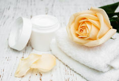 Rose with moisturiser cream and towels Royalty Free Stock Photo